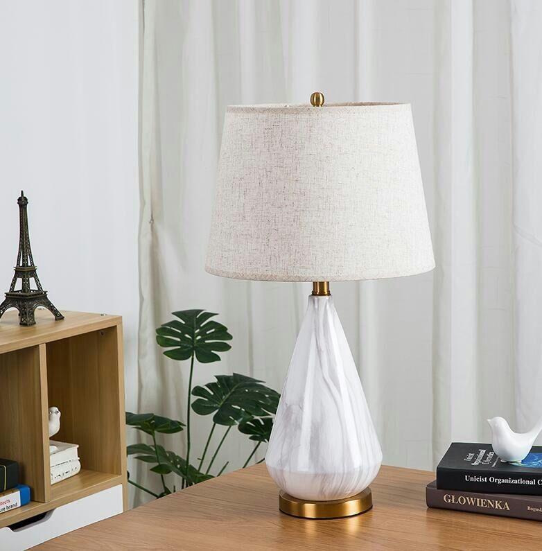 Đèn Tinama đá cẩm thạch trong không gian phòng khách. Giúp tôn lên vẻ đẹp và sự sang trọng