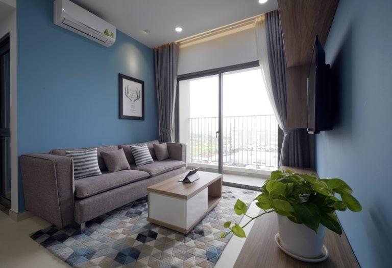 Không gian nội thất căn hộ xinh xắn với tone màu xanh nổi bật.