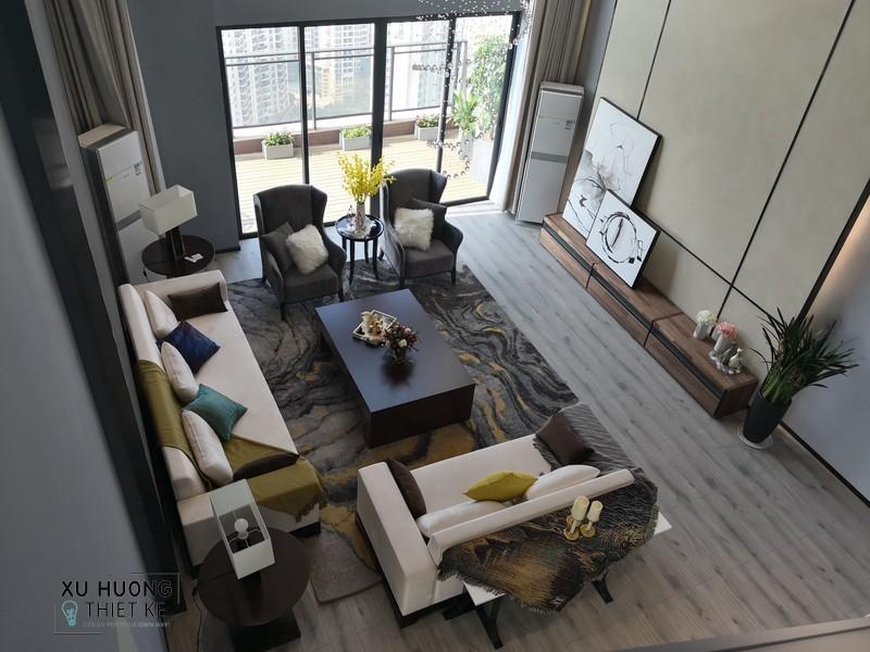 Tượng chim gốm passer mạ vàng trong không gian phòng khách